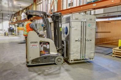 CryoLogistics SnowSHIP Unit being moved by forklift in a refrigerated warehouse