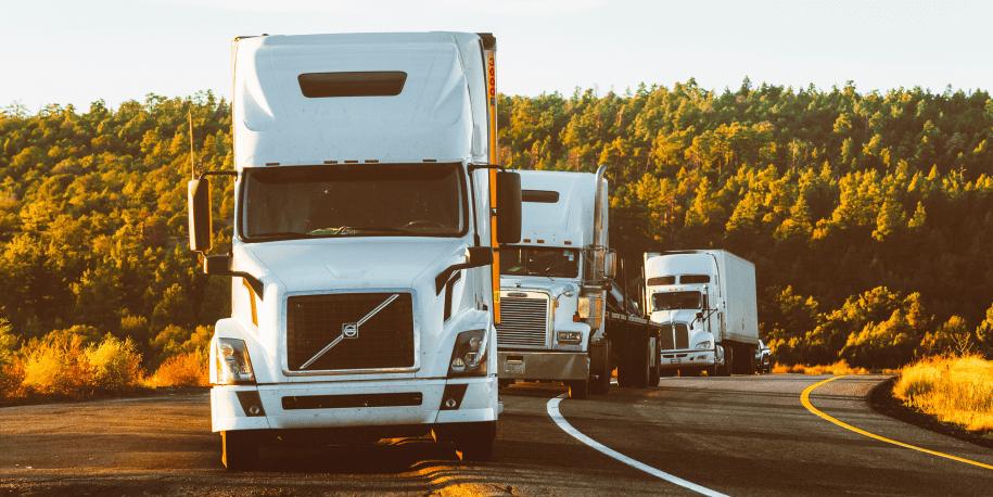 Trucks driving down the road