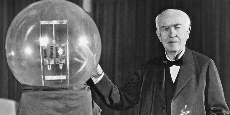 Thomas Edison next to his innovation
